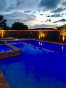 gorgeous pool and lighting at night - pool has a light show setting